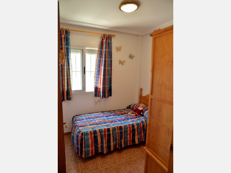 Фото Бунгало с 3 спальнями в Punta Prima